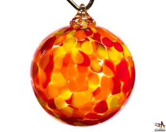 Hand Blown Glass Ornament with Large Red Orange and Yellow Dots