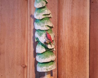 Evergreen tree with two Cardinals handcarved