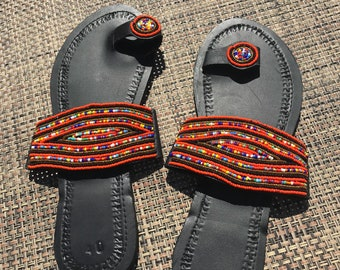 This is leather made sandal enhaced with some Africans beads easy to wear and very comfortble for any occasion sizes vary text me for info