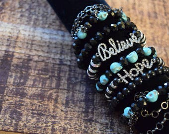 Past Forever Collection 7 strand stackable stretch bracelet set 3, black and teal skull beads