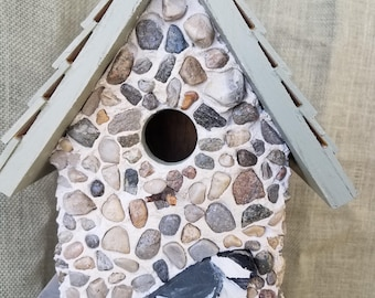 Sage green stone birdhouse. Chickadee hand-painted in wood, cedar shingles and hanging wire.