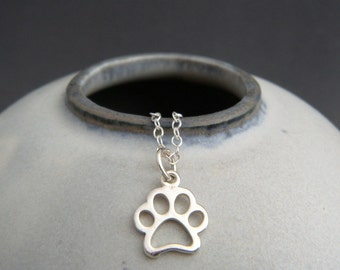 tiny silver paw print necklace. small sterling silver pet pride pendant. openwork charm. gift animal lover simple pawprint dog cat jewelry