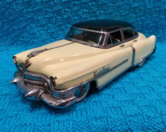 Marusan Toys 1950's Kosuge Cadillac battery electric car. yellow and green friction tin toy car #2203 minicar