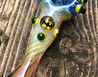 BATMAN Glass pipe  BATMAN  millie with yellow and blue highlights. Fumed with silver and gold, color changing. Awesome piece