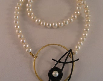 Uniquely designed handmade clasp with pearl necklace