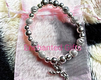 Handmade bracelet with Silver beads and a Tibetan silver charm