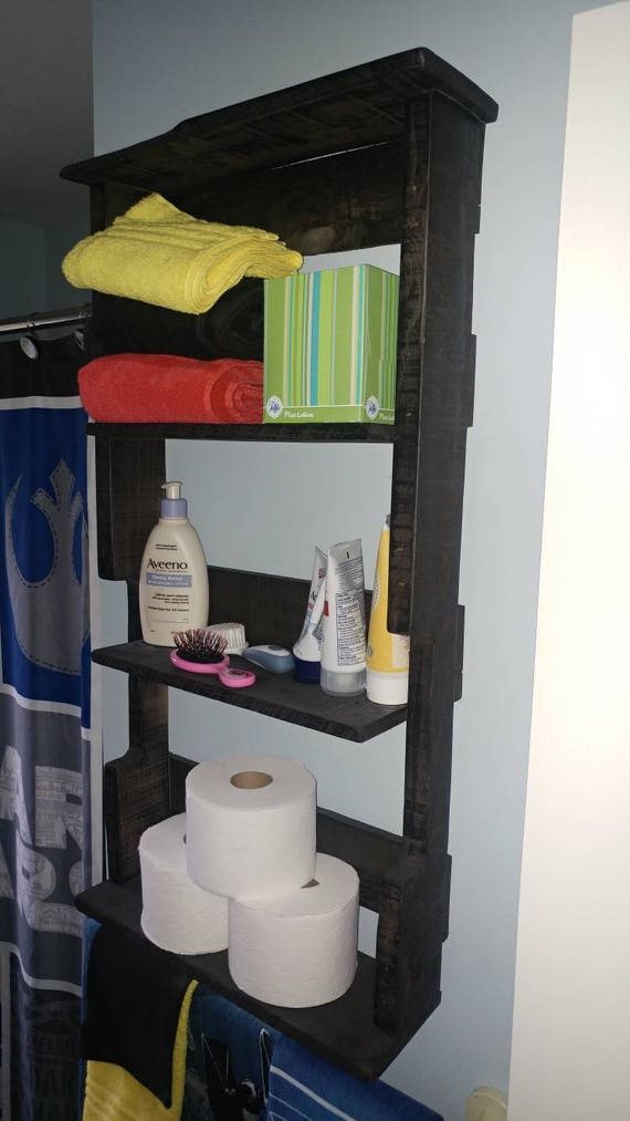 Wall hanging storage shelf. Made from pallet wood. Can finish in any paint or stain color.