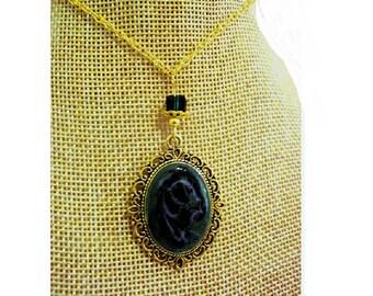 Vintage necklace gold, green galaxy cabochon