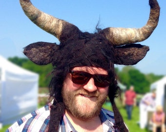 Black Taurus bull hat with posable horns for pagan festival theatrical hand felted headdress