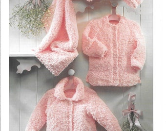 Original Sirdar knitting pattern for 2 versions of cardigan, hat and blanket.  To fit birth to 6 years / 16 - 26 ins / 41 - 66 cms.