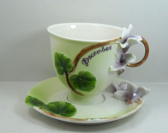 China tea cup December month with flower decor