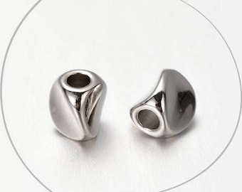 Set of 2 beads, twisted, silver plated brass, 5 x 4 x 4 mm, hole 2 mm
