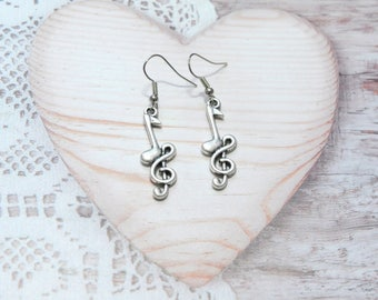 Pair of earrings jewelry dangle treble clef music note