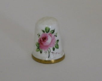 Hand painted bone china thimble, signed by the artist.