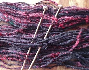 Black Cherry Bombshell bulky art yarn with alpaca, locks and sparkle
