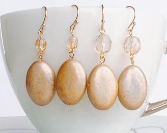 Venetian Glass bead dangling earrings. Golden brown coloured oval bead earrings. Light bronze colour. Iridescent.