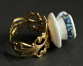 Teacup Ring in White with Blue Geometric Design. Tea Cup Ring. Gold Filigree Adjustable Ring. Blue Ring. Gold Ring. Handmade Jewelry.