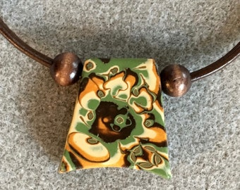 Dramatic polymer clay pendant necklace in an organic green, gold, brown, cream and copper design