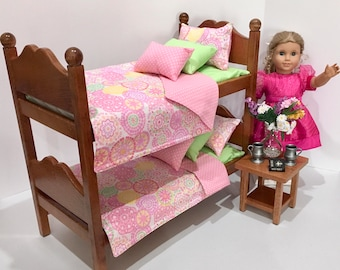 American doll bunk beds with pink and mint green bedding