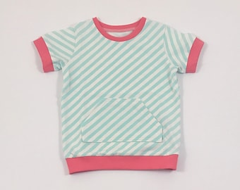 Mint Stripes Shirt. Boys Tee Shirt. Organic Cotton Shirt. Jersey Knit Tee Shirt. Canguru Pocket. Boy Tee. Coral Cuffed Sleeve. Short Sleeve.