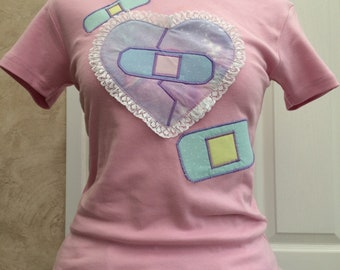 Colourful Bandaids T-shirt in Pink