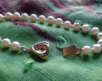 Vintage Knotted Pearl Bracelet   With a Gold plated  triangle Clasp.