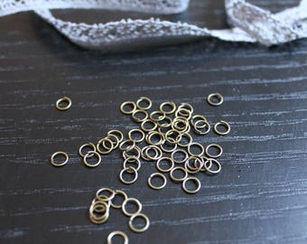 50 rings metal bronze plated to make bracelets