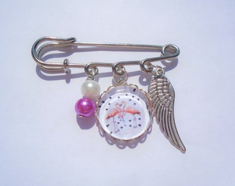 Broche cabochon flamands roses