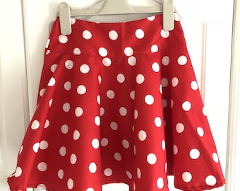 Minnie Mouse inspired skirt, in toddler size, with elasticated waist in a red and white polka dot style and optional lace edge