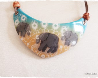 Made entirely of polymer clay elephant bib necklace. Elephant necklace