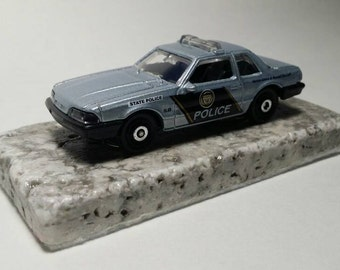 1993 Mustang LX police car desk or office paperweight tumbled marble base felt lined.