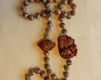 SALE 20% Off Vintage Hand Made Necklace Of Leopard Skin Jasper Beads And Olive Wood Carvings On Hand Knotted Silk