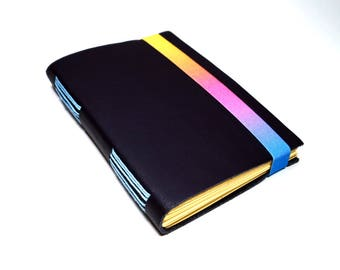magical hand-bound  leather notebook with a colorful rubber band