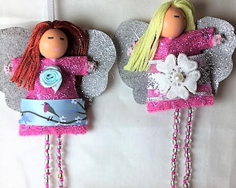 Hanging angel with pink dress and silver wings