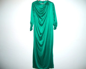 Long Sleeve Green Satin Dress, with ruched sleeves and flower corsage at shoulder, ready to ship