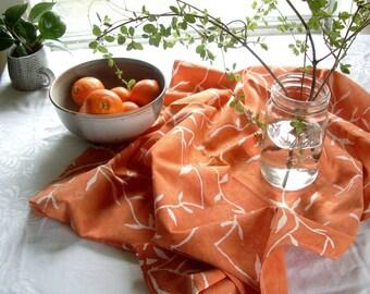 batik floursack towel. pale rust orange