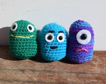 A trio of crocheted monsters!