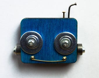 Blue robot magnet with bolts and screws