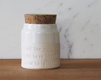 urn on collared shape. Optional quote shown. your choice of size, clay, glaze, text, and stamp options.  urn for ashes or pet urn.
