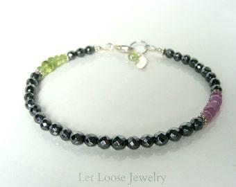 Peridot pink sapphire hematite bracelet, slim pink green gray, genuine stones sterling silver asymmetrical, Let Loose Jewelry, under 50