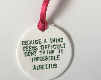 Clay 'Because a thing seems difficult doesn't mean it's impossible' hanging