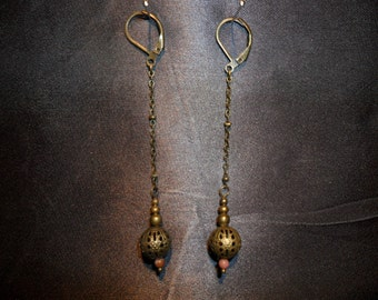 """scourge of weapon"" and rhodonite earrings"