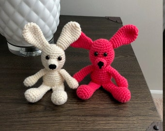 Double Trouble!!  2 cute and colorful rabbits waiting for young child to love them