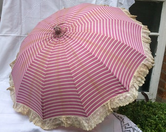 Antique Pink/White Parasol, striped with lace edging and wooden handle.