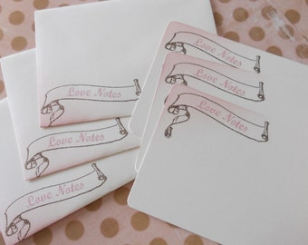 Romantic flat note card stationery set hand stamped with 'Love Notes' inside a vintage scroll, pink & brown, set of 10.