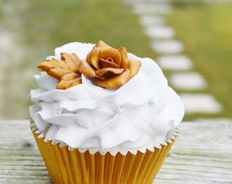 One gold rose cupcake (fake)