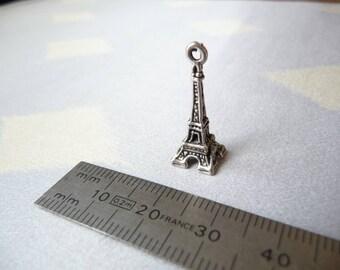 A tiny silver Eiffel Tower