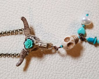 Southwest inspired hand painted cow skull charm with Turquoise and pearl.