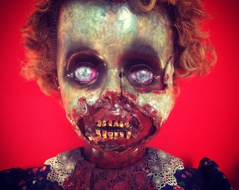 Dee Sgusting is a OOAK zombie baby art doll