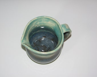 Porcelain pitcher, wheel thrown one of a kind ceramic medium sized